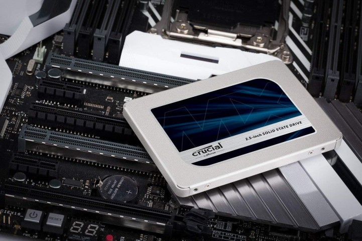 Crucial MX500 SSD on top of a motherboard.
