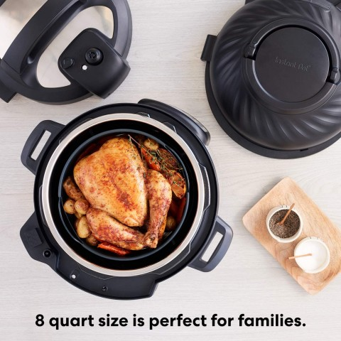 Picture of the instant pot duo crisp with a chicken inside and both lids shown.