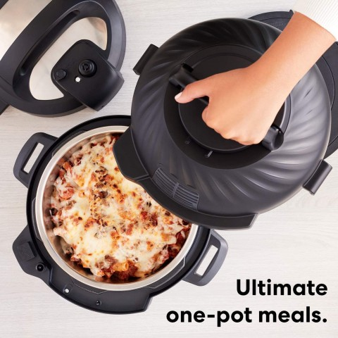 Picture of the Instant Pot Duo Crisp with pasta in the pot and someone putting the air fryer lid on it but that really makes no sense because why would you air fry what looks like lasagna?