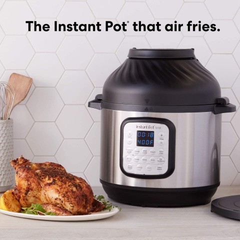 Picture of the front of the instant pot duo crisp with the air fryer lid on and a roasted chicken.